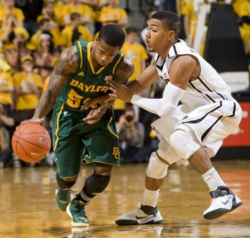 Baylor's Pierre Jackson, left, forces his way around Missouri's Phil Pressey, right, during the first half of an NCAA college basketball game Saturday, Feb. 11, 2012, in Columbia, Mo. (AP Photo/L.G. Patterson)