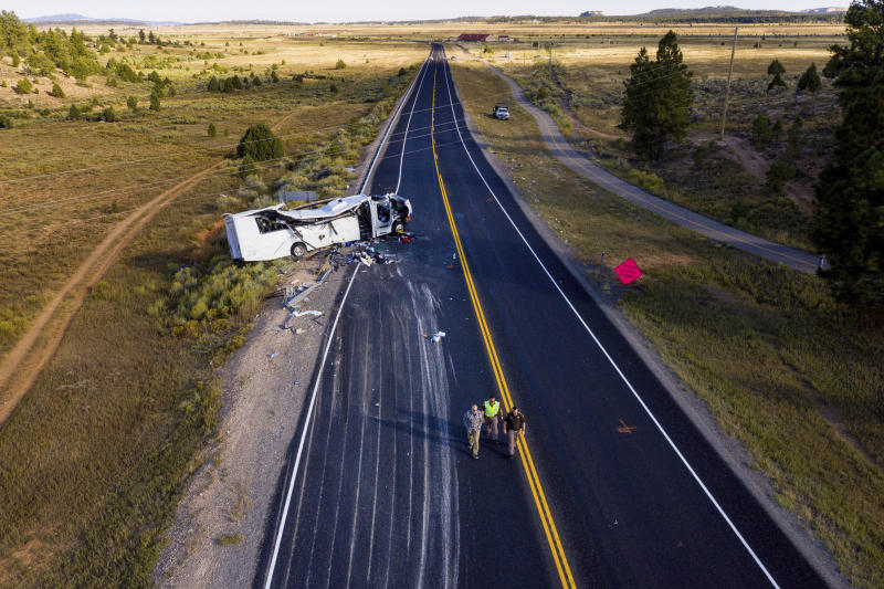 The remains of a bus that crashed while carrying Chinese-speaking tourists lie along State Route 12 near Bryce Canyon National Park, Friday, Sept. 20, 2019, in Utah, as authorities continue to investigate. (Spenser Heaps/The Deseret News via AP)
