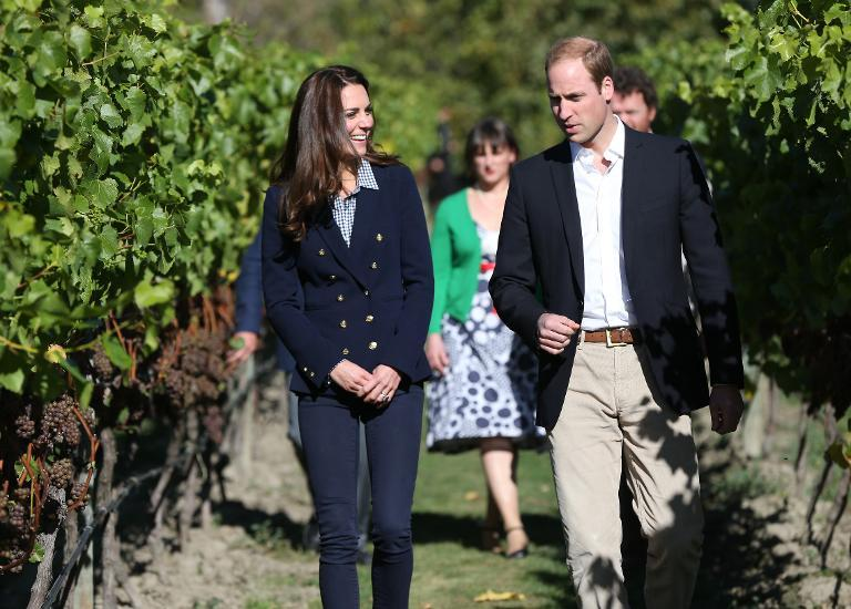 Britain's Prince William and his wife Catherine, the Duchess of Cambridge, walk around the vineyard during a visit to the Amisfield Winery in Queenstown on April 13, 2014