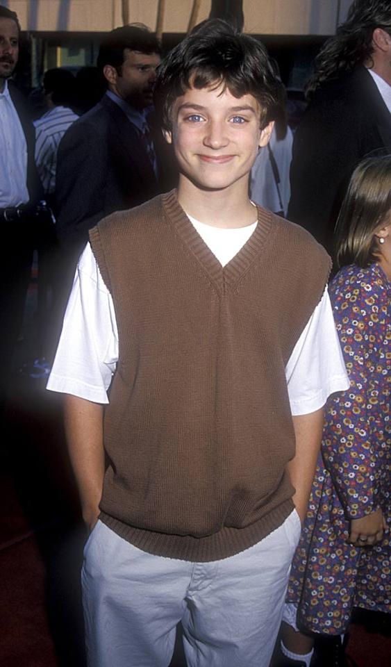 "At 13, blue-eyed cutie Elijah Wood was already making waves with his roles in the thriller ""The Good Son"" with Macaulay Culkin, and ""Forever Young"" with Mel Gibson. Barry King/<a href=""http://www.wireimage.com"" target=""new"">WireImage.com</a> - July 1, 1994"
