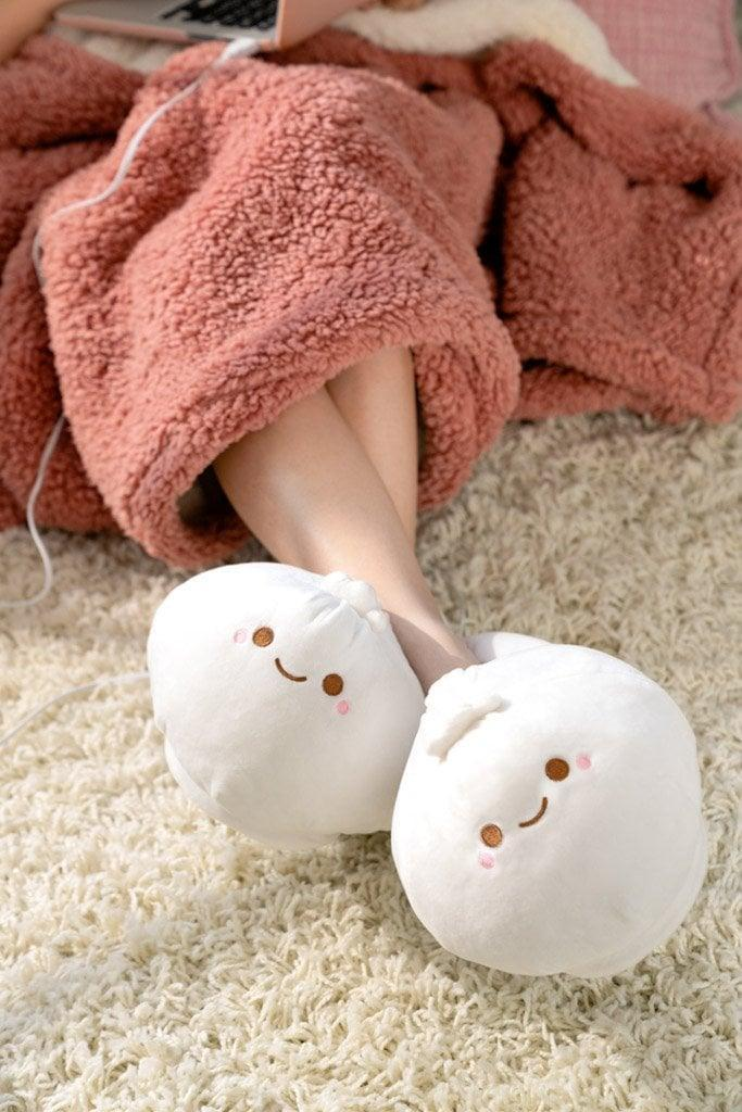 <p>Even when they're running around doing a million things, they'll be so in love with these cute <span>Smoko Heated Slippers</span> ($35).</p>