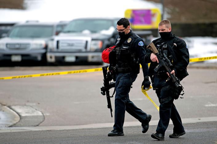 Police officers walk through the parking lot of the King Soopers grocery store in Boulder, Colorado on 22 March, 2021 after reports of an active shooter. The shooting left 10 people dead. (AFP via Getty Images)