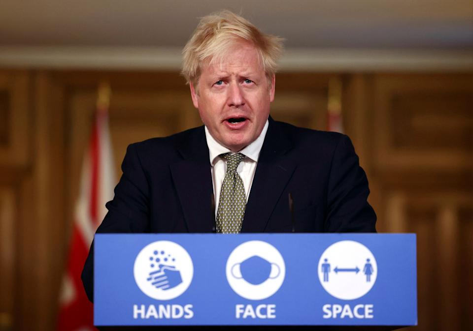 <strong>Boris Johnson speaks during a coronavirus briefing in Downing Street.</strong> (Photo: ASSOCIATED PRESS)