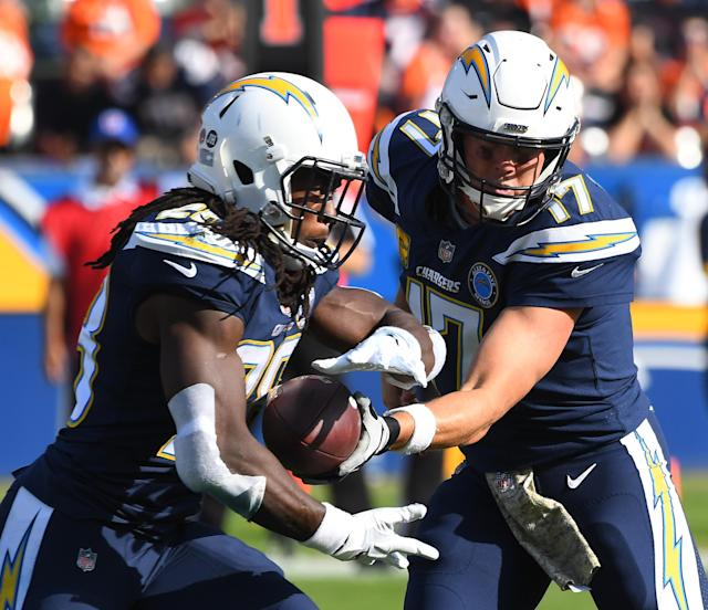 Chargers quarterback Philip Rivers (R) said he supports running back Melvin Gordon (L) who wants a contract extension from Los Angeles. (Getty Images)