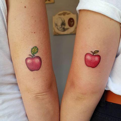"""<p>If I'm being honest, I don't even <em>really</em> care for apples but I'd still consider getting this couples <a href=""""http://www.cosmopolitan.com/style-beauty/beauty/g33023737/beach-tattoo-ideas/"""" rel=""""nofollow noopener"""" target=""""_blank"""" data-ylk=""""slk:tattoo"""" class=""""link rapid-noclick-resp"""">tattoo</a>. Between the red ink and the leaf detailing, it's kinda too good to pass up on.</p><p><a href=""""https://www.instagram.com/p/CBx9bnBo6rh/?utm_source=ig_embed&utm_campaign=loading"""" rel=""""nofollow noopener"""" target=""""_blank"""" data-ylk=""""slk:See the original post on Instagram"""" class=""""link rapid-noclick-resp"""">See the original post on Instagram</a></p>"""