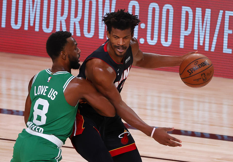 Jimmy Butler #22 of the Miami Heat drives the ball against Kemba Walker #8 of the Boston Celtics during the third quarter in Game Four of the Eastern Conference Finals