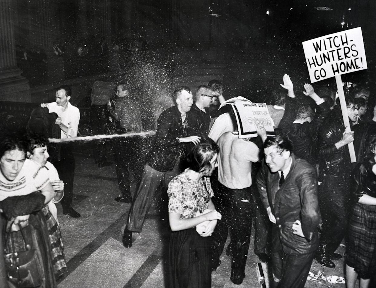 Police hose demonstrators in San Francisco's City Hall who are protesting against the House Un-American Activities Committee in 1960. (Photo: Bettmann Archive/Getty Images)
