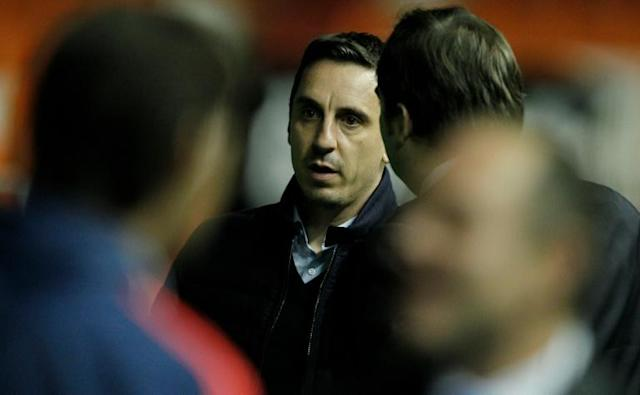 Valencia's coach Gary Neville looks on before the Spanish league football match Valencia CF vs Real Madrid CF at the Mestalla stadium in Valencia on January 3, 2016