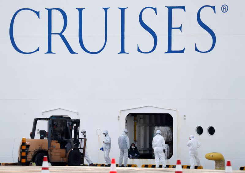 Workers in protective gear load supplies into the cruise ship Diamond Princess at Daikoku Pier Cruise Terminal in Yokohama, south of Tokyo