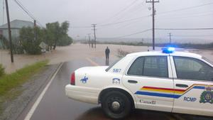 Water from the North River floods a highway the Truro-Bible Hill area of Nova Scotia Monday.