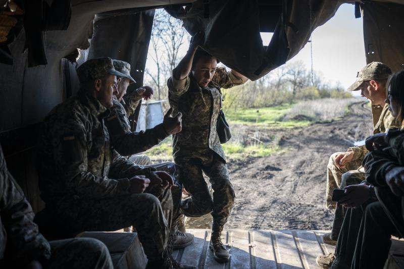 A Ukrainian serviceman scrambles into a military truck near the front line as the conflict continues in Donetsk region, eastern Ukraine, Sunday, April 21, 2019. Top issues in the election have been corruption, the economy and how to end the conflict with Russia-backed rebels in eastern Ukraine. (AP Photo/Evgeniy Maloletka)