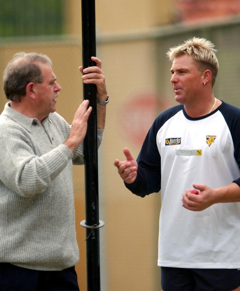 16 Oct 2001:  Victorian bowler Shane Warne with former test spinner Terry Jenner at the nets at Adelaide Oval prior to the Victoria v South Australia Pura Cup match.  DIGITAL IMAGE Mandatory Credit: Tony Lewis/ALLSPORT