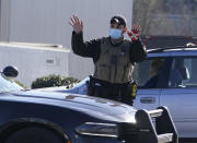 A police officer directs traffic following a liquid nitrogen leak that killed six people at Prime Pak Foods, a poultry plant, on Thursday, Jan. 28, 2021, in Gainesville, Ga. (AP Photo/John Bazemore)