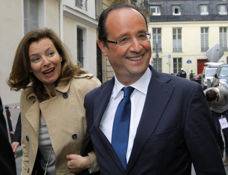 "FILE - French Socialist Party candidate for the upcoming French presidential election Francois Hollande and his companion French journalist Valerie Trierweiler, left, in Paris in this file photo dated Thursday, April 5, 2012. According to reports on Friday July 13, 2012, Hollande is widely expected to break his silence about ""tweetgate"", the alleged family feud involving the mother of his children Segolene Royal, his eldest son Thomas and his current companion Valerie Trierweiler, that has riveted the media and the Internet, during a television interview to be broadcast Saturday July 14. (AP Photo/Jacques Brinon, File)"