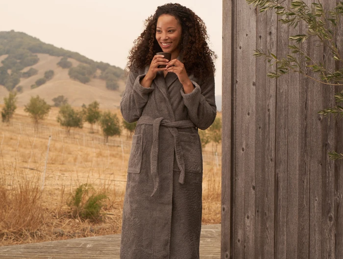 """<h2>Coyuchi Cloud Loom Organic Robe</h2><br>This plush robe is made with 100% organic cotton that's been specially processed to be extra smooth and absorbent. It features a relaxed fit with a shawl collar and side-seam pockets. <br><br><br><strong>Coyuchi</strong> Unisex Cloud Loom™ Organic Robe, $, available at <a href=""""https://go.skimresources.com/?id=30283X879131&url=https%3A%2F%2Fwww.coyuchi.com%2Funisex-cloud-loom-robe.html"""" rel=""""nofollow noopener"""" target=""""_blank"""" data-ylk=""""slk:Coyuchi"""" class=""""link rapid-noclick-resp"""">Coyuchi</a>"""