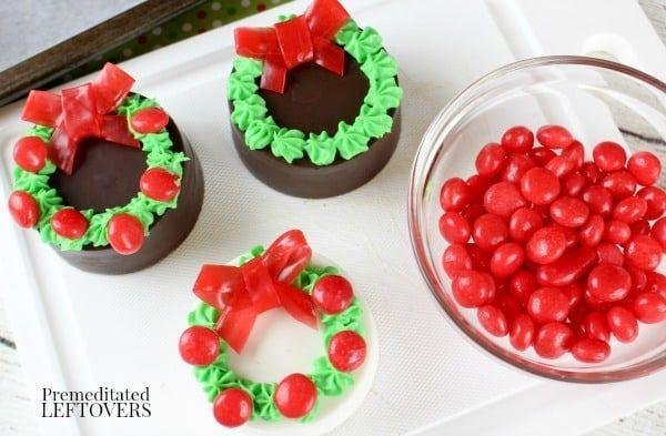 """<p>It doesn't get much more adorable than these mini wreaths made out of Oreos and fruit roll-up bows.</p><p><strong>Get the recipe at <a href=""""https://premeditatedleftovers.com/recipes-cooking-tips/oreo-wreath-cookies/"""" rel=""""nofollow noopener"""" target=""""_blank"""" data-ylk=""""slk:Premeditated Leftovers"""" class=""""link rapid-noclick-resp"""">Premeditated Leftovers</a>. </strong> </p>"""