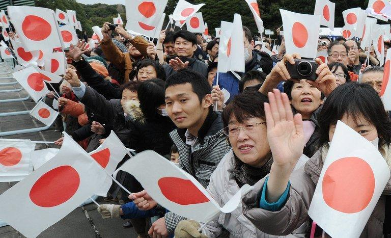 Supporters celebrate the birthday of Emperor Akihito at the Imperial Palace in Tokyo on December 23, 2012. The Japanese throne is held in deep respect by much of the public, despite being stripped of much of its mystique and its quasi-divine status in the aftermath of World War II
