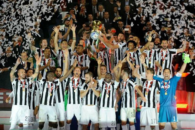Juventus won the Coppa Italia for the fourth year running and a record 13th time with a crushing 4-0 victory over AC Milan who suffered a second-half meltdown in the final on Wednesday.