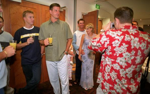 25 Dec 1999:  Australian cricket team members, Brett Lee (left) and Michael Kasprowicz watch Michael Slater take a picture of Greg Blewett and friend during the Australian team's  Christmas lunch at their team hotel this morning. Tommorrow Australia playIndia at the Melbourne Cricket Ground, Melbourne, Australia, in the Boxing Day Test Match. Mandatory Credit: Jack Atley/ALLSPORT