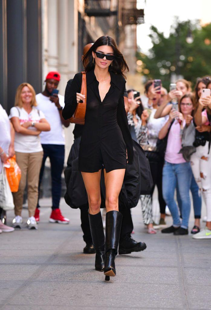 <p>Kendall Jenner turned the streets of New York City into her runway in a '70s-inspired collared dress, which she paired with matching knee-high boots. </p>