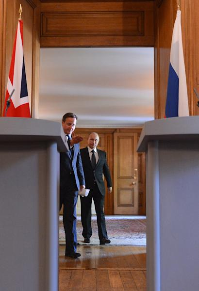 British Prime Minister David Cameron, left, arrives with Russian President Vladimir Putin to a press conference at 10 Downing Street, London, Sunday June 16, 2013. Cameron meets with Russian President Putin for talks on the Syrian crisis amid fears that differences between Moscow and the West are pushing the two sides towards a new Cold War. (AP/Anthony Devlin, PA Wire) UK OUT - NO SALES - NO ARCHIVES