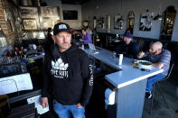 Brian Gruber, owner of Notorious Burgers, is photographed at his restaurant in Carlsbad, Calif., on Friday, Dec. 18, 2020. (AP Photo/Ringo H.W. Chiu)