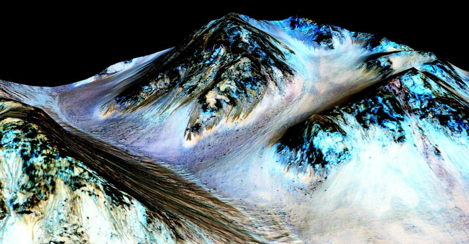 File: Nasa's Mars Reconnaissance Orbiter handout shows dark, narrow streaks on the slopes of Hale Crater (Getty Images)