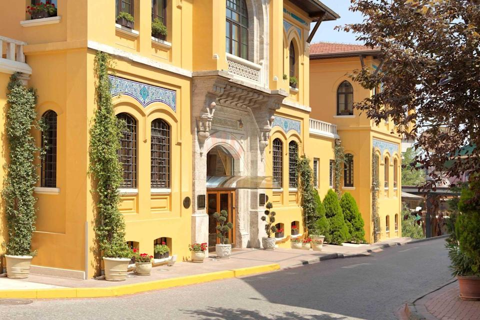 Yellow exterior of the Four Seasons Hotel Istanbul at Sultanahmet, voted one of the best hotels in the world