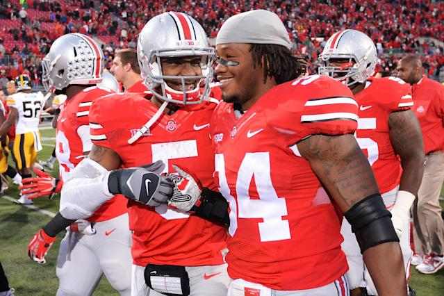 COLUMBUS, OH - OCTOBER 19: Quarterback Braxton Miller #5 of the Ohio State Buckeyes celebrates with Jamal Marcus #34 of the Ohio State Buckeyes after the Buckeyes defeated the Iowa Hawkeyes 34-24 at Ohio Stadium on October 19, 2013 in Columbus, Ohio. (Photo by Jamie Sabau/Getty Images)