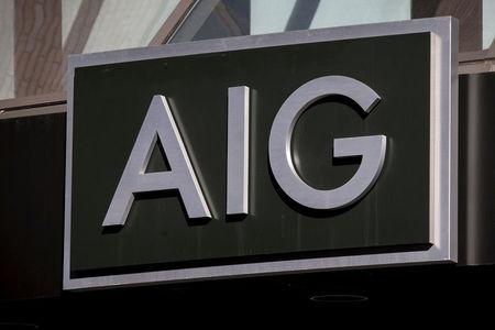 FILE PHOTO: The AIG logo is seen at its building in New York's financial district in New York, NY, U.S. on March 19, 2015.   REUTERS/Brendan McDermid/File Photo