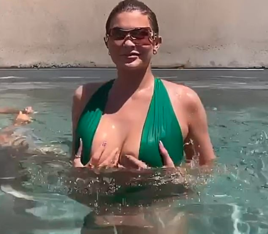 Kylie Jenner in a pool holding her boobs