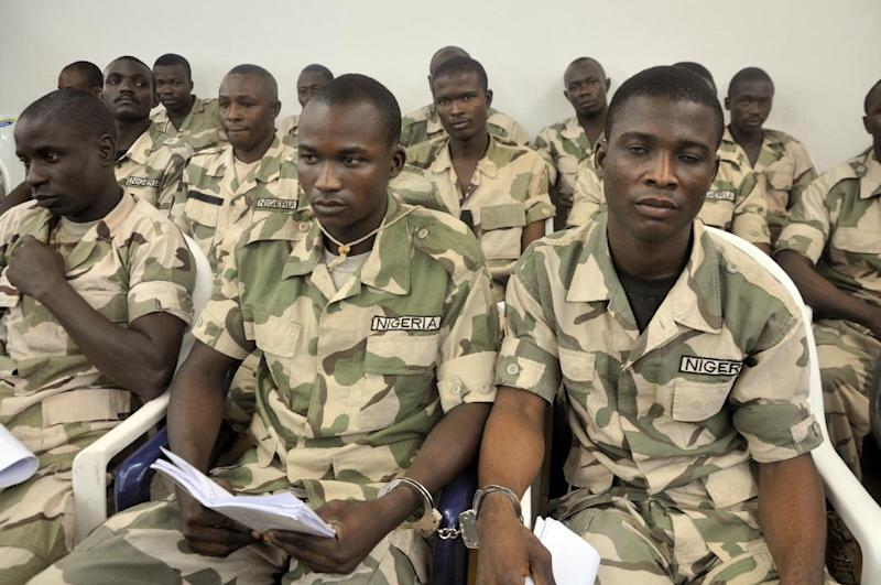 Some of Nigerian soldiers facing trial on charges of mutiny and conspiracy to commit mutiny over claims that they refused to fight Boko Haram militants, on October 15, 2014 in the military courtroom in Abuja (AFP Photo/)