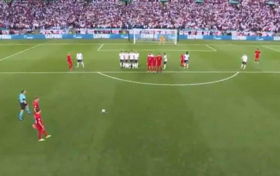 Screengrab shows Denmark's players approaching England's wall - ITV/UEFA