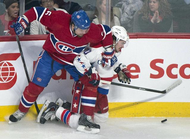 Montreal Canadiens' Douglas Murray, left, holds off Washington Capitals' Marcus Johansson during the first period of an NHL hockey game in Montreal, Saturday, Jan. 25, 2014. (AP Photo/The Canadian Press, Graham Hughes)