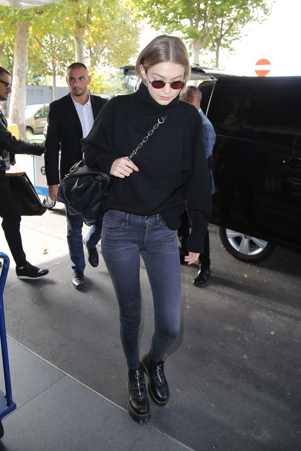 <p>In a chunky black turtleneck sweater, black skinny jeans, platform zip-up boots, an oversized crossbody bag, and rounded sunglasses while out in Milan. </p>