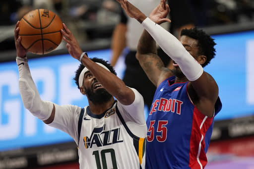 Utah Jazz guard Mike Conley (10) is defended by Detroit Pistons guard Delon Wright (55) during the first half of an NBA basketball game, Sunday, Jan. 10, 2021, in Detroit. (AP Photo/Carlos Osorio)