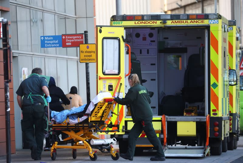 Paramedics transfer a patient outside the Royal London Hospital , amid the coronavirus disease (COVID-19) outbreak, in London