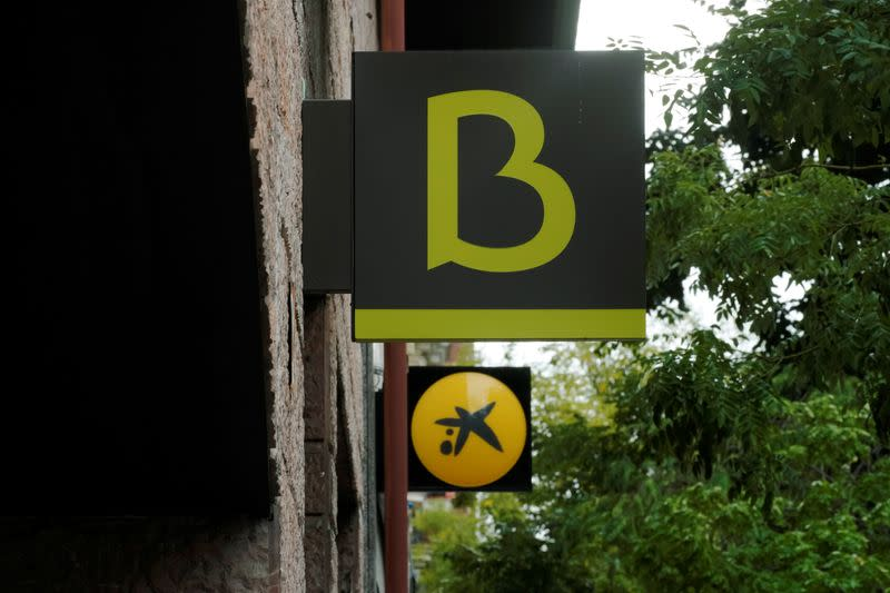 And logo of Bankia and Caixabank are seen in Madrid
