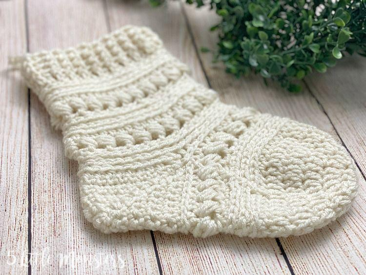 """<p>This beautiful bead stitch is so rich in texture the stocking doesn't need to be colorful to be striking.</p><p><strong>Get the tutorial at <a href=""""https://www.5littlemonsters.com/2020/07/bead-stitch-christmas-stocking.html"""" rel=""""nofollow noopener"""" target=""""_blank"""" data-ylk=""""slk:5 Little Monsters"""" class=""""link rapid-noclick-resp"""">5 Little Monsters</a>.</strong></p><p><a class=""""link rapid-noclick-resp"""" href=""""https://www.amazon.com/Scissors-Yarn-Knitting-Crochet/s?k=Scissors&rh=n%3A262625011&tag=syn-yahoo-20&ascsubtag=%5Bartid%7C10050.g.28872655%5Bsrc%7Cyahoo-us"""" rel=""""nofollow noopener"""" target=""""_blank"""" data-ylk=""""slk:SHOP SCISSORS"""">SHOP SCISSORS</a><br></p>"""