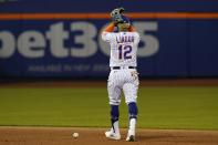 New York Mets shortstop Francisco Lindor (12) reacts after committing an error, allowing Chicago Cubs' Ian Happ to reach first during the eighth inning of a baseball game Thursday, June 17, 2021, in New York. The Cubs shut out the Mets, 2-0. (AP Photo/Kathy Willens)
