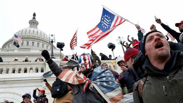 PHOTO: A Three Percenters flag is carried by people who broke into the Capitol grounds to contest the certification of the 2020 presidential election results, at the U.S. Capitol Building in Washington, D.C., Jan. 6, 2021.  (Shannon Stapleton/Reuters, FILE)
