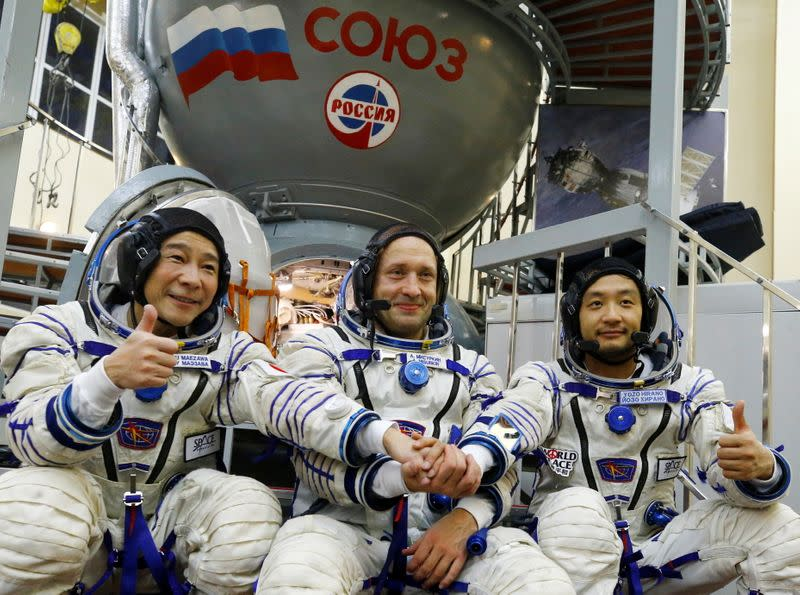 Cosmonaut Alexander Misurkin and space flight participants Yusaku Maezawa and Yozo Hirano attend a training session ahead of the expedition to the ISS, in Star City