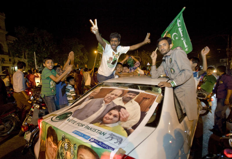 Supporters of Pakistan Muslim League-N party celebrate the primary unofficial results of their country's parliamentary elections in Lahore, Pakistan Saturday, May 11, 2013. Former Pakistani Prime Minister Nawaz Sharif declared victory following a historic election marred by violence Saturday, a remarkable comeback for a leader once toppled in a military coup and sent into exile. (AP Photo/Anjum Naveed)