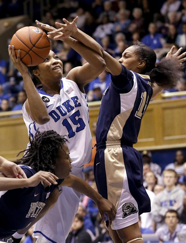 Duke's Richa Jackson (15) drives between Pittsburgh's Loliya Briggs, left, and Marquel Davis during the first half of an NCAA college basketball game in Durham, N.C., Sunday, Jan. 26, 2014. (AP Photo/Gerry Broome)