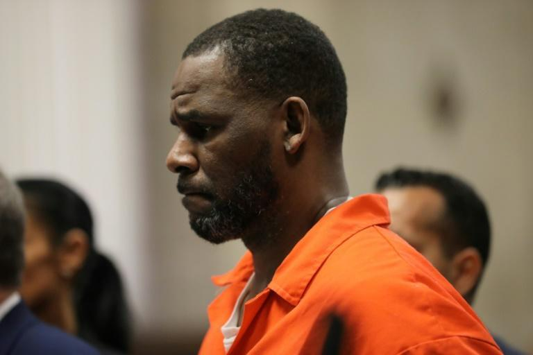 Singer R. Kelly, pictured during a hearing at the Leighton Criminal Courthouse in Chicago, Illinois in 2019, was convicted of leading a decades-long sex crime ring on September 27, 2021 (AFP/Antonio PEREZ)