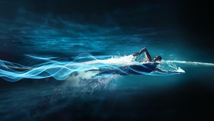 """<span class=""""caption"""">Swimming offers a host of beneficial effects on the brain.</span> <span class=""""attribution""""><a class=""""link rapid-noclick-resp"""" href=""""https://www.gettyimages.com/detail/photo/man-swimming-crawl-leaving-streaks-of-light-royalty-free-image/537601927?adppopup=true"""" rel=""""nofollow noopener"""" target=""""_blank"""" data-ylk=""""slk:Stanislaw Pytel/Stone via Getty Images"""">Stanislaw Pytel/Stone via Getty Images</a></span>"""