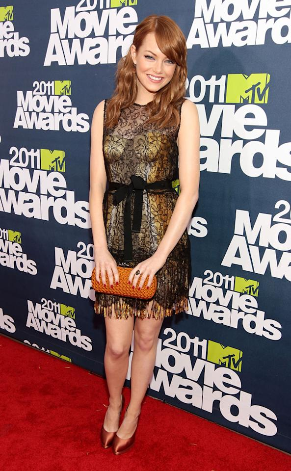 Emma Stone's flirty lace Bottega Veneta sheath is the perfect fit for walking the red carpet at the 2011 MTV Movie Awards on June 5, 2011.