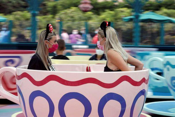 PHOTO: Visitors enjoy the Mad Hatters Tea cups at Disneyland Paris as the theme park reopens its doors to the public in Marne-la-Vallee in France, July 15, 2020. (Charles Platiau/Reuters)