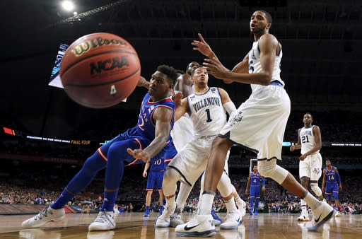 Kansas forward Silvio De Sousa, left, fights for a loose ball with Villanova's Jalen Brunson (1) and Mikal Bridges, right, during the first half in the semifinals of the Final Four NCAA college basketball tournament, Saturday, March 31, 2018, in San Antonio. (AP Photo/Chris Steppig, NCAA Photos Pool)