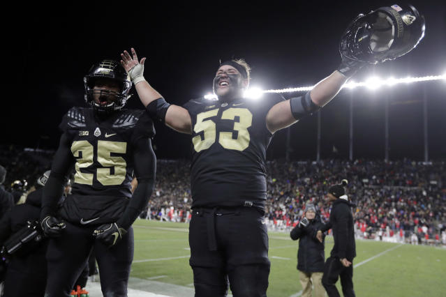 Purdue center Kirk Barron (53) and running back Tario Fuller (25) celebrate late in the second half of an NCAA college football game against Ohio State in West Lafayette, Ind., Saturday, Oct. 20, 2018. Purdue defeated Ohio State 49-20. (AP Photo/Michael Conroy)